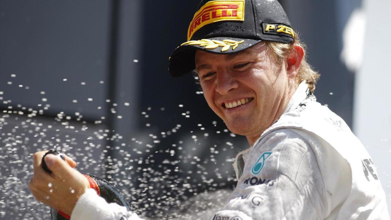 Nico Rosberg (GER) Mercedes AMG F1 celebrates on the podium.