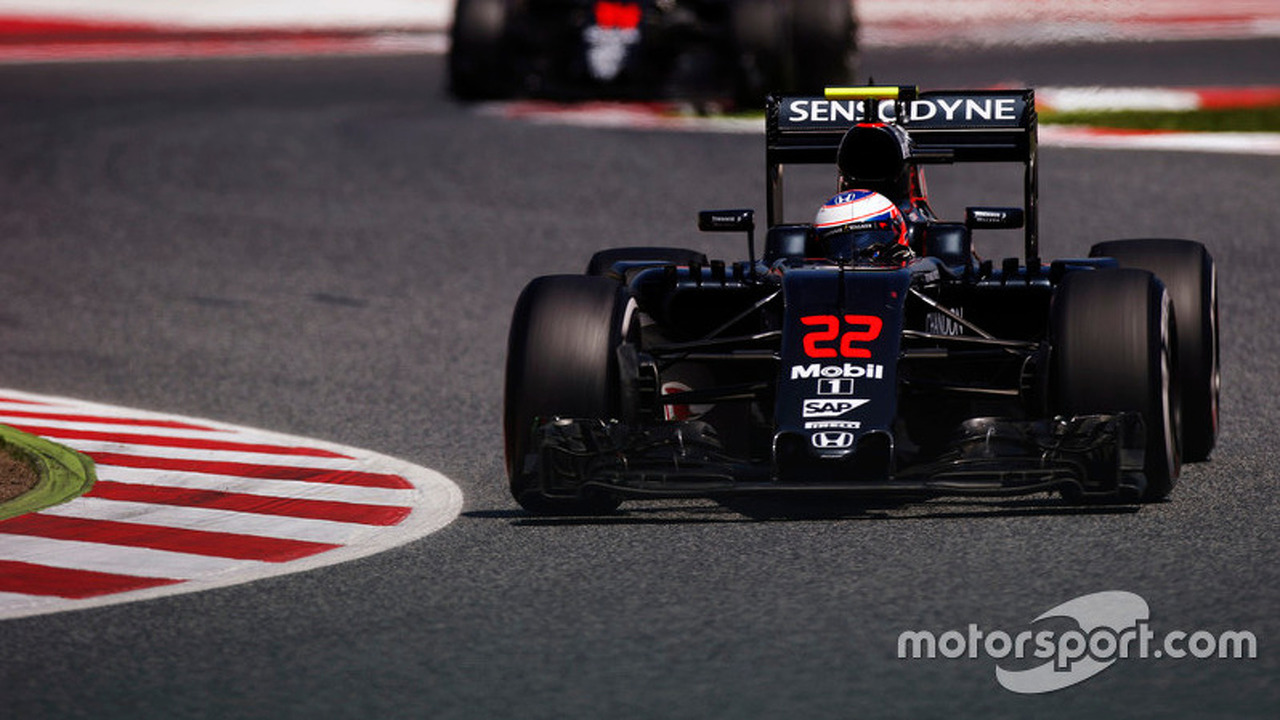 Jenson Button, McLaren MP4-31 on track ahead of Fernando Alonso, McLaren MP4-31