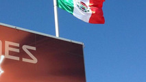 Mexican flag with marijuana leaf above McLaren merchandise stall 16.11.2013 United States Grand Prix