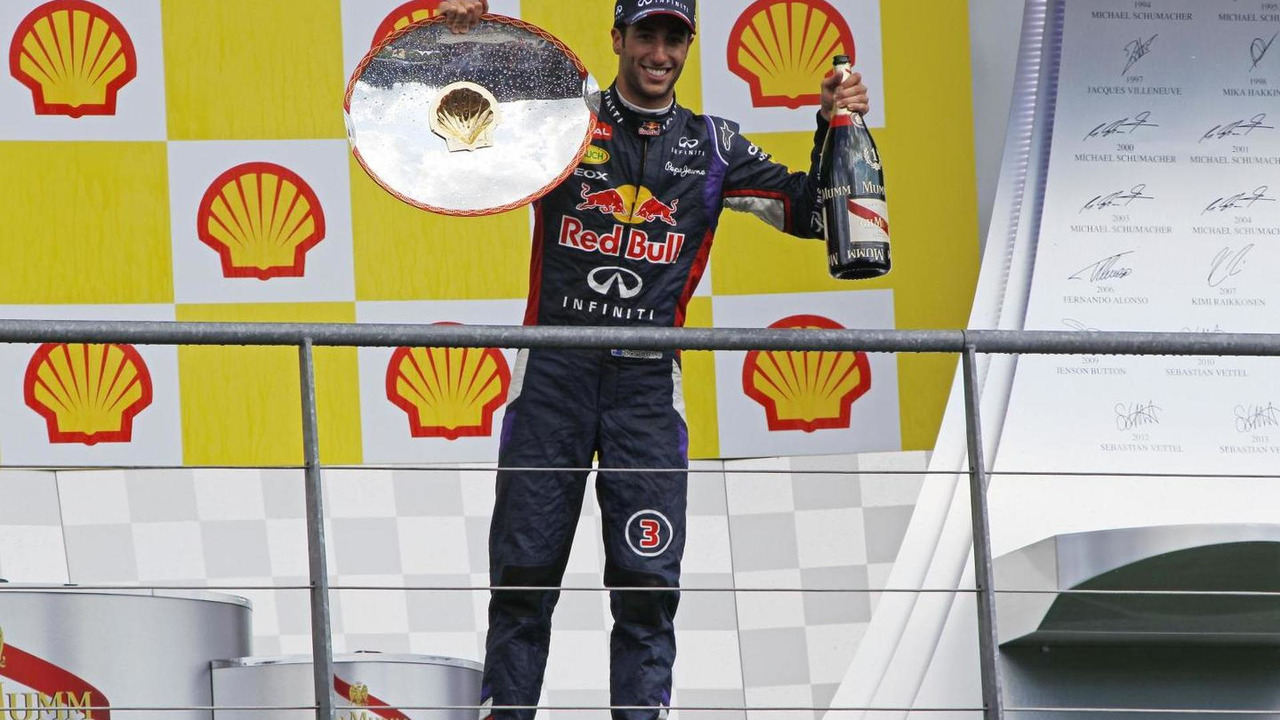 Race winner Daniel Ricciardo (AUS) celebrates on the podium, 24.08.2014, Belgian Grand Prix, Spa Francorchamps / XPB