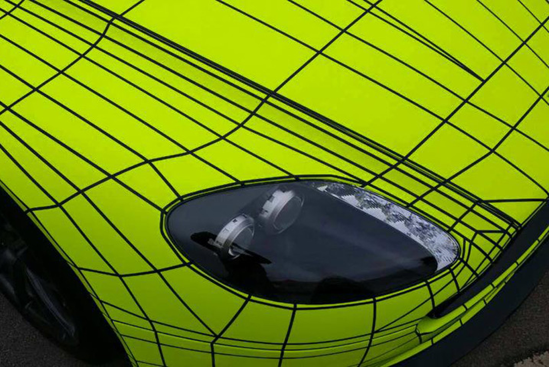 Fluorescent Aston Martin Vantage Wrap Actually Looks Good