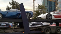 Marussia B2 and B1 being transported uncovered through Moscow
